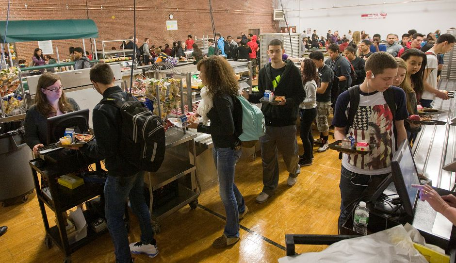 Students make their way through the lunch lines in the temporary cafeteria at Maloney High School in Meriden, Monday, March 30, 2015.  | Dave Zajac / Record-Journal