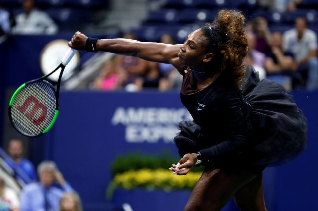 Serena Williams, of the United States, serves to Karolina Pliskova, of the Czech Republic, during the quarterfinals of the U.S. Open tennis tournament Tuesday, Sept. 4, 2018, in New York. (AP Photo/Adam Hunger)