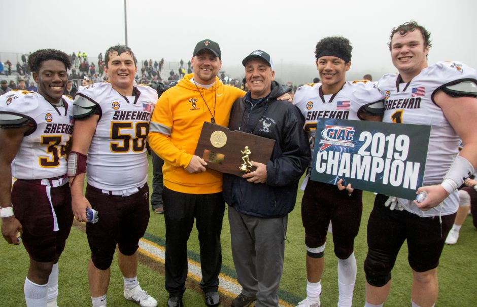 Sheehan's Terrence Bogan left, Thomas DiPasquale, John Ferrazzi, Jordan Davis and Braedon McCarthy receive their plaque after beating Bloomfield High School at Trumbull High School during the CIAC Class S Championship Football game. Aaron Flaum, Record-Journal
