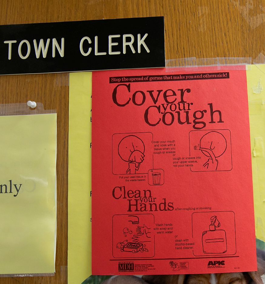 "A ""Cover your Cough"" sign posted on the entrance doors to Wallingford Town Hall, Mon., Mar. 16, 2020. Wallingford Town Hall remains open. Dave Zajac, Record-Journal"