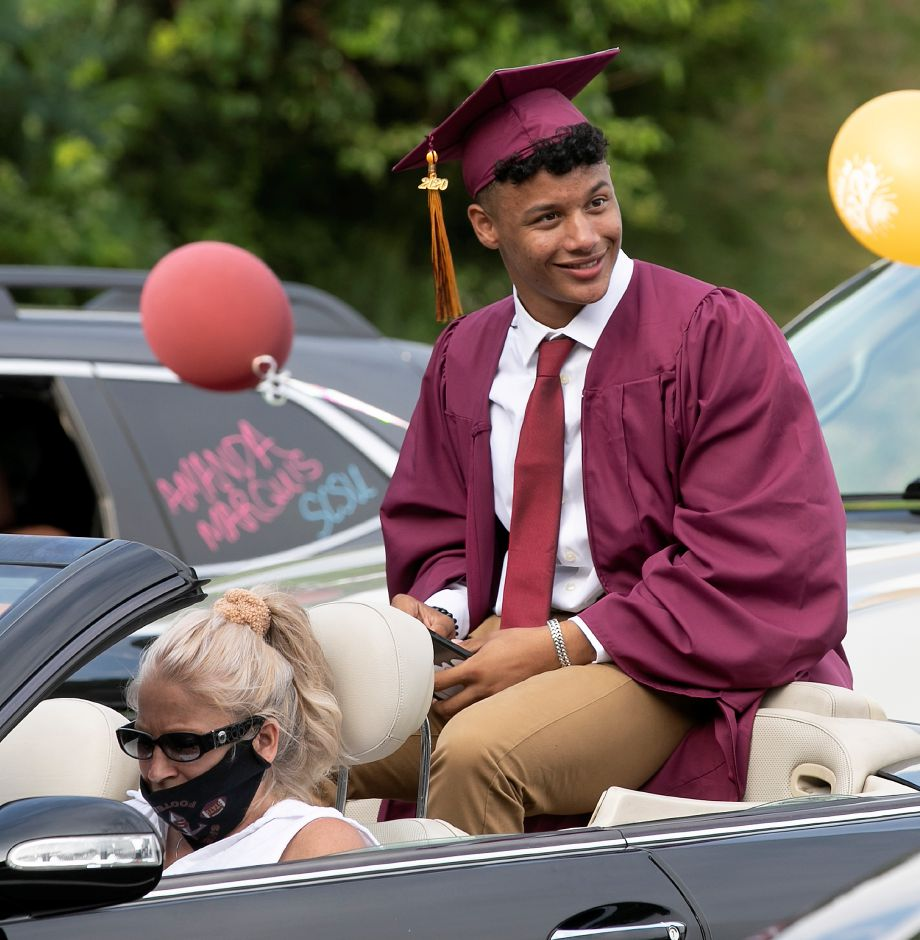 Graduate Jordan Davis sits in the back of his mother Tammy
