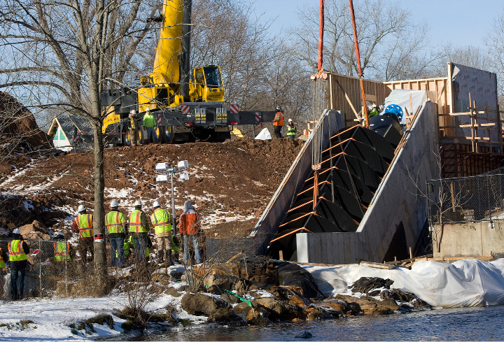 A 20-ton, 35-foot-long metal screw is set in place at Hanover Dam in South Meriden, Tuesday morning, December 20, 2016. The Archimedes screw, named for the ancient Greek scientist credited with its invention, is the first of its kind installed in the U.S.  | Dave Zajac, Record-Journal