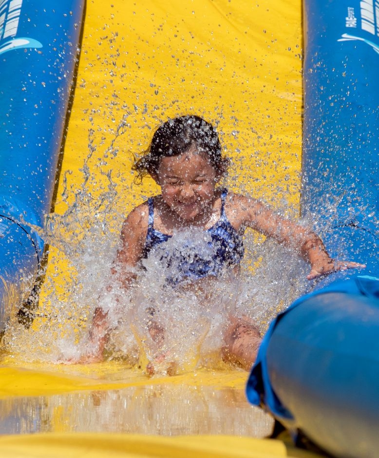 Camper Emma Chow, 6, splashes at the bottom of the Turbo Chute.