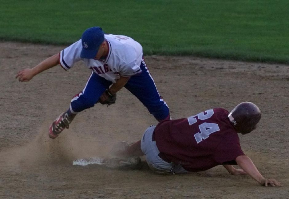 Southington 2nd baseman Joe Lopa jumps out of the way after tagging out Naugatuck runner #24 trying to steal 2nd Tues., June 8, 1999 in their semi-final round at New Britain