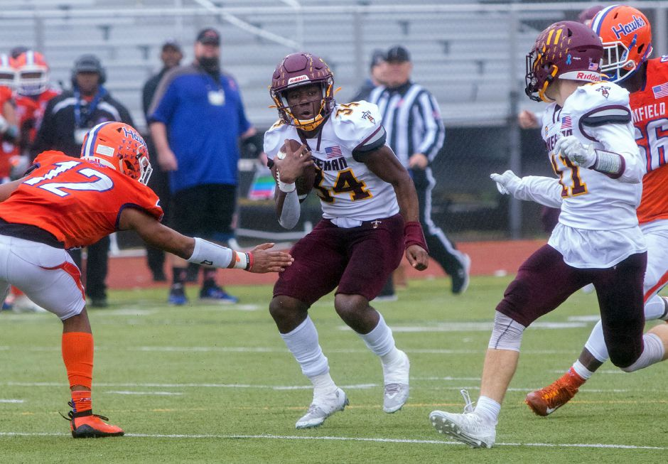 Sheehan's Terrence Bogan runs for yardage against Bloomfield during the first half of Saturday's CIAC Class S state championship game at Trumbull High School. Aaron Flaum, Record-Journal