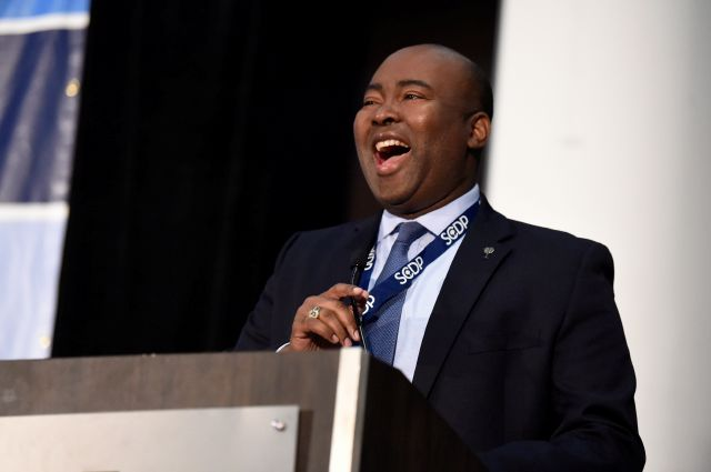 FILE - In this Dec. 14, 2019 file photo, Democrat Jaime Harrison, who is seeking to challenge Republican U.S. Sen. Lindsey Graham, speaks to Democrats gathered at the Spratt Issues Conference in Greenville, S.C. U.S. Sen. Lindsey Graham has been outraised for the first time by his Harrison, Democratic challenger, in a record-breaking quarterly period that sets up a multimillion-dollar grudge match leading into the general election. Harrison announced late Wednesday, April 14, 2020, that...