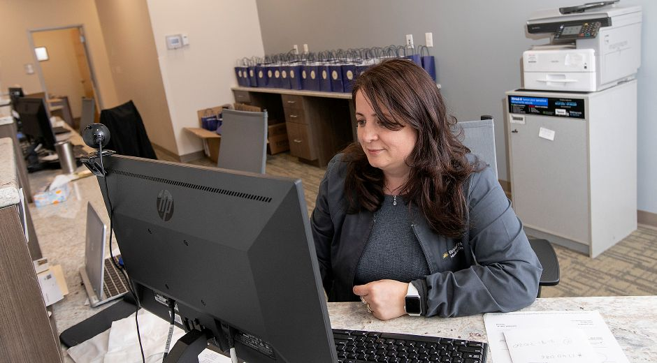 Elsa Pasha, medical assistant, works at her desk at the new Bristol Health, 167 Main St. Southington, Thurs., Feb. 13, 2020. Dave Zajac, Record-Journal