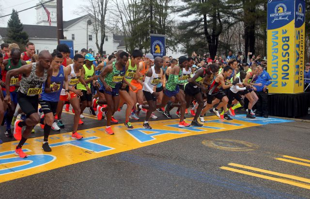 FILE - In this April 15, 2019, file photo, the elite men break from the start of the 123rd Boston Marathon in Hopkinton, Mass. The 2020 Boston Marathon, which was rescheduled to run on Sept. 14th, was canceled Thursday May 28, 2020 for the first time in its 124-year history due to the COVID-19 virus outbreak. (AP Photo/Stew Milne, File)