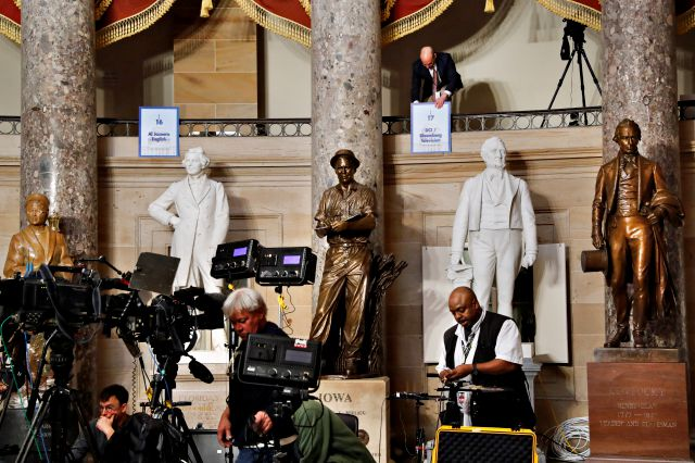 Television crews set up their equipment in Statuary Hall in the Capitol, Tuesday, Feb. 5, 2019, ahead of President Donald Trump