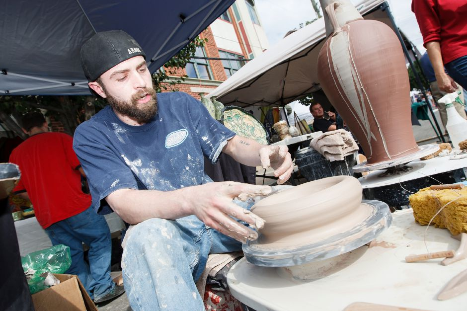 Justin Gerace of Southington shapes clay on a potter
