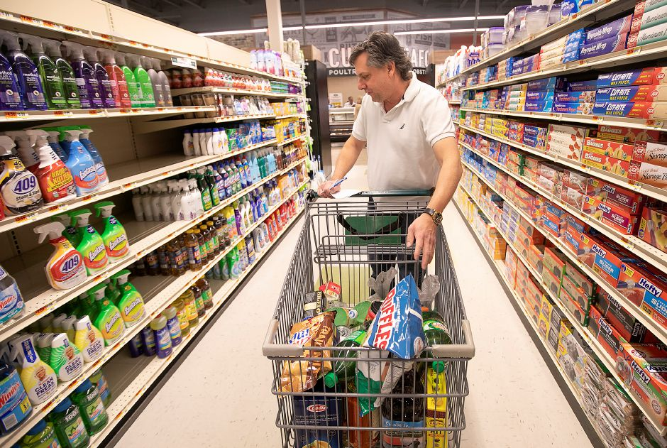 Mike Ryan, of Southington, shops for groceries during the grand opening of the new Tops Marketplace, 887 Meriden-Waterbury Tpke., Fri., Mar. 27, 2020. The family-owned grocery store has spent the last year in rebuild mode after a March 3 fire destroyed the building. Dave Zajac, Record-Journal