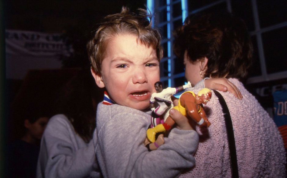 "RJ file photo - Josh LaFrance, 2, wails after getting a close look at one of his TV wrestling heroes, the Undertaker, at the Meriden Square Mall Jan. 19, 1994. Holding Josh is his mother, Pam LaFrance. ""He loves to see them on TV, but when he sees them in person he cries,"" she said."