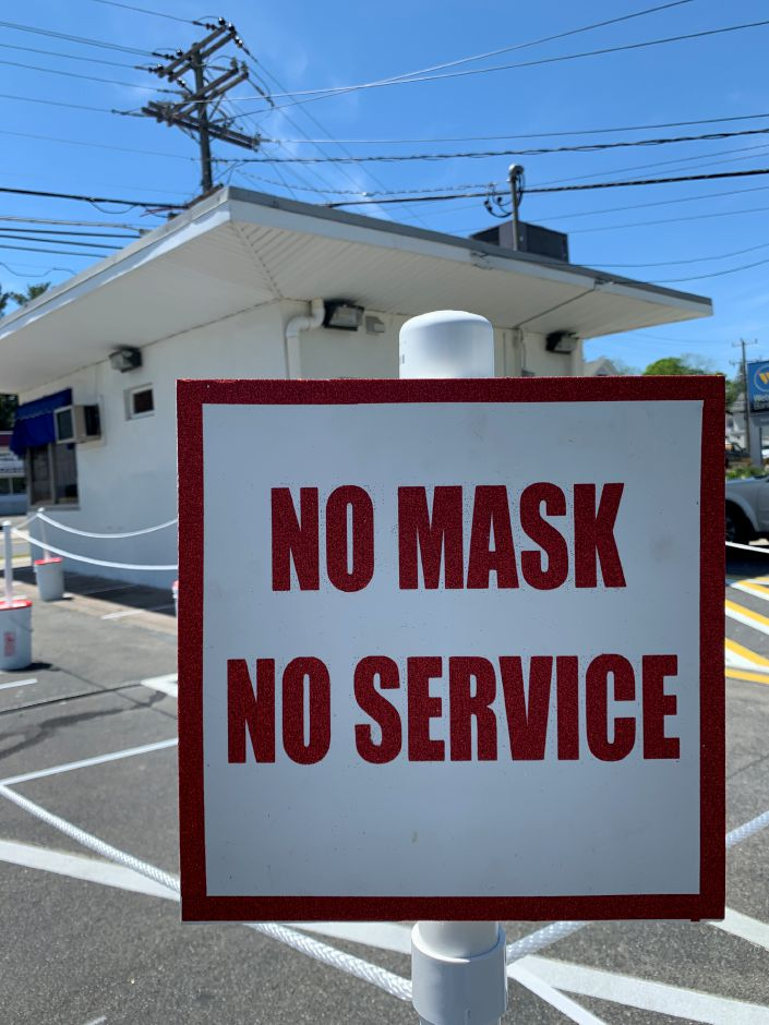 "This sign reads ""NO MASK NO SERVICE"" outside Les' Dairy Bar in Meriden."