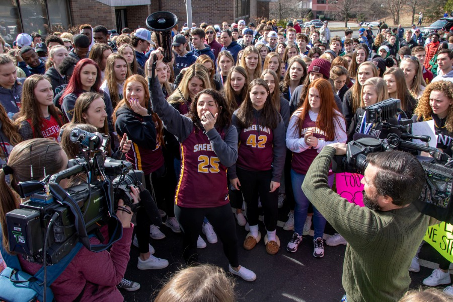Sheehan girl's basketball player Mia Mills uses a megaphone during a rally Wednesday morning as students from across the state gather at CIAC headquarters in Cheshire to protest the CIAC's decision to cancel the rest of the winter postseason due to rising concerns over the COVID-19 coronavirus. Aaron Flaum, Record-Journal