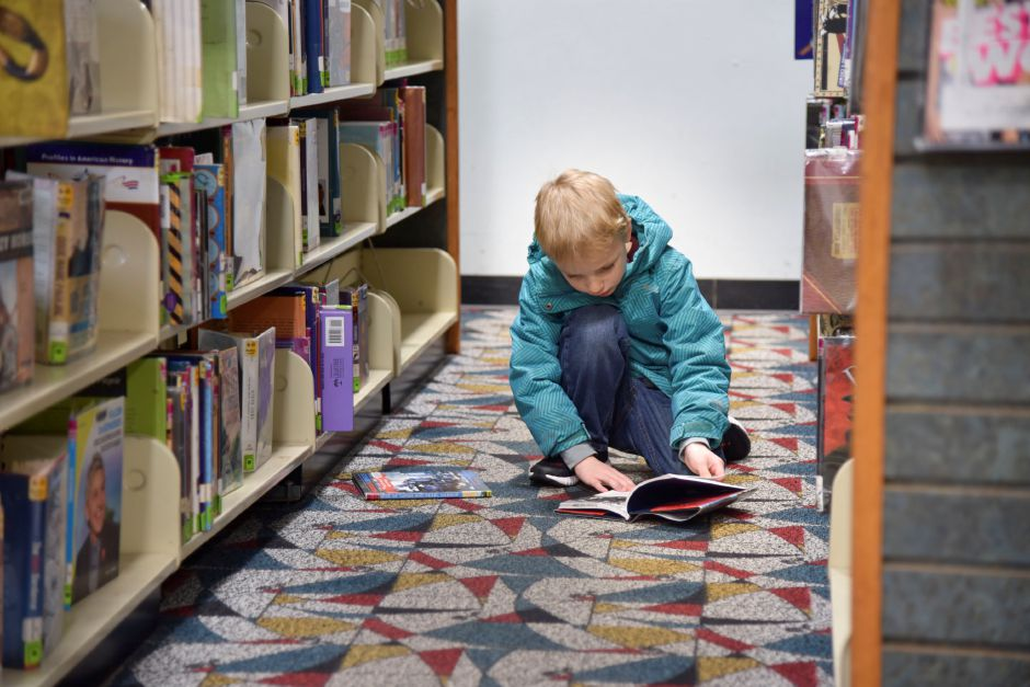 Southington resident Greyson Churchill, 6, browses books at the Southington Public Library, 255 Main St., on Monday, Dec. 30, 2019. The town is looking to build a new, larger library to accomodate growing needs. | Bailey Wright, Record-Journal