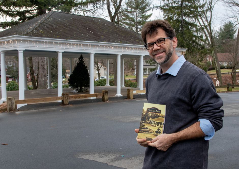 "Justin Piccirillo in front of the gazebo at Hubbard Park in Meriden on December 31, 2020, with his book ""Hubbard Park (Images of America)."" Aaron Flaum, Record-Journal"