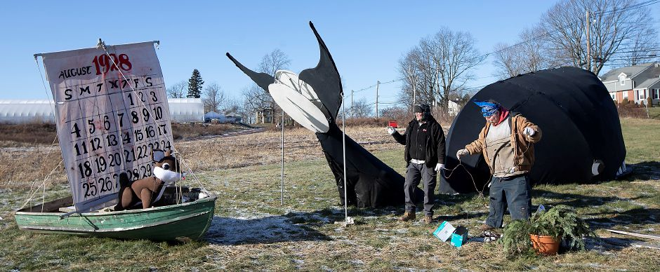 At left, Billy Beaumont, owner of Beaumont Farm, and Shannon Sims, of Meriden, finish setting up the last props  for the farm's annual Christmas display.