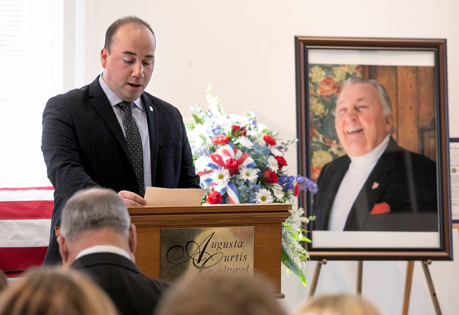 Mayor Kevin Scarpati reads a letter from President Donald J. Trump offering his condolences to the family of Walter A. Shamock Jr. during a memorial service at the Augusta Curtis Cultural Center in Meriden, Thurs., Dec. 12, 2019. Shamock, a former realtor and Korean War veteran, was a longtime postal worker before he retired and joined the Meriden City Council in 1989. Dave Zajac, Record-Journal