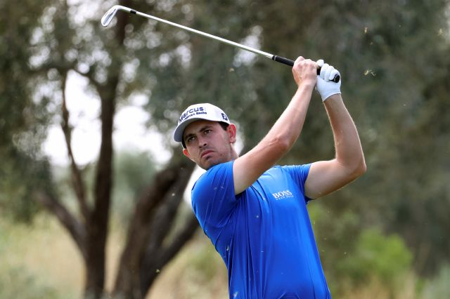 Patrick Cantlay watches his tee shot on the eighth hole during the second round of the Shriners Hospitals for Children Open golf tournament at TPC Summerlin in Las Vegas, Friday, Oct. 9, 2020. (Erik Verduzco/Las Vegas Review-Journal via AP)