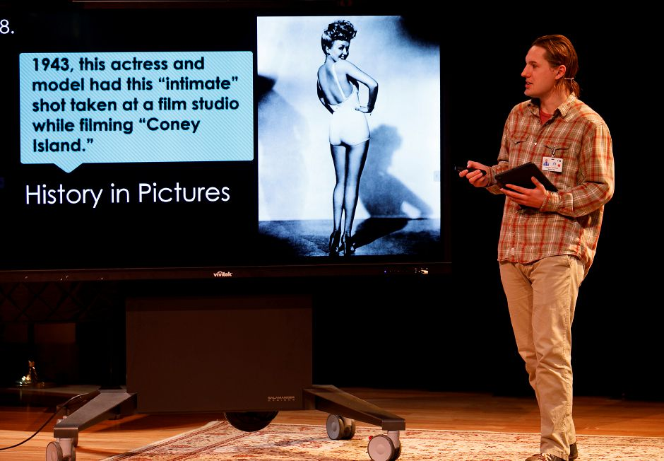 Tim Gadomski, production coordinator, asks seniors to identify actress Betty Grable on Tuesday during Pop Quiz, a virtual televised trivia program at Elim Park in Cheshire. Seniors watch the program from their apartments and call in to the studio set up inside the facility