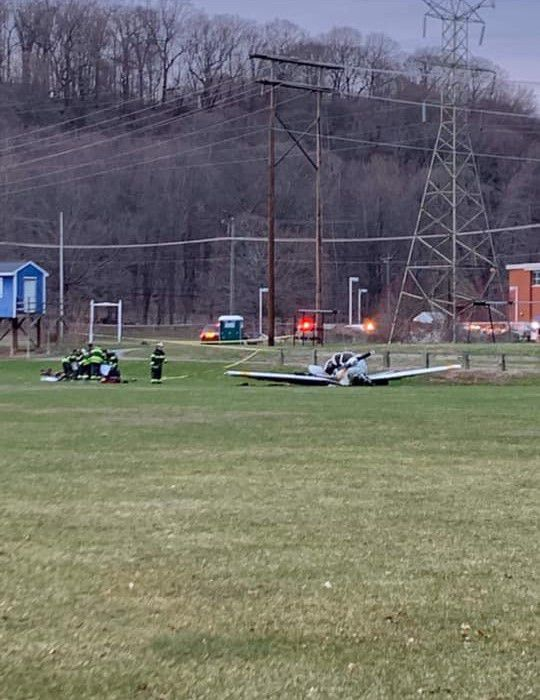 Emergency personnel respond to a small plane crash in the ball field between Wilcox Technical and Platt high schools in Meriden on Thursday.