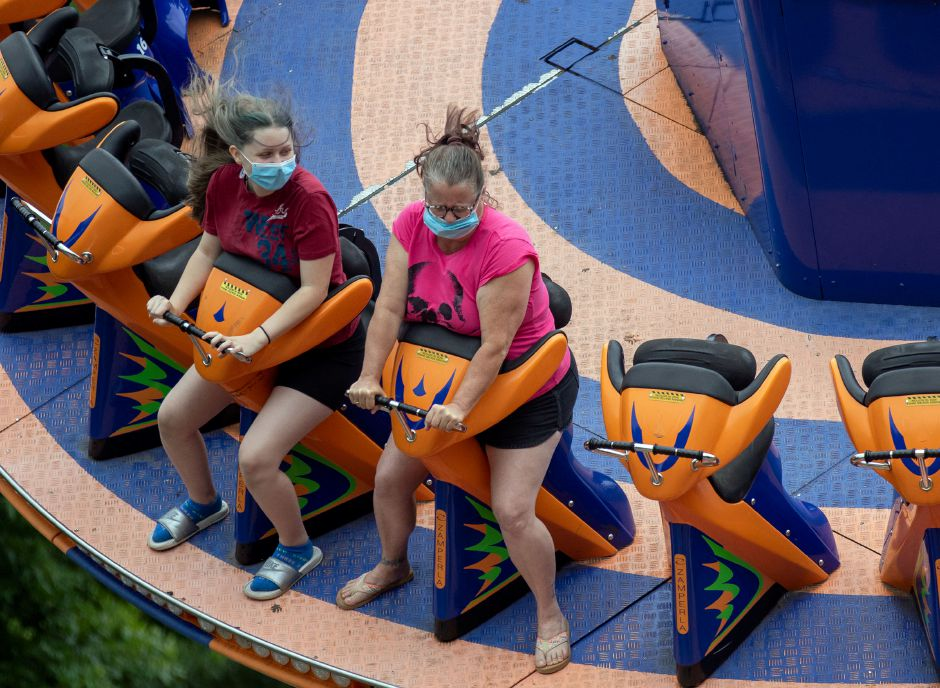 Katelyn Darabas left and her mom Ann Darabas both from Hartford, hold on tight as they ride Rev-O-Lution at Lake Compounce on Tuesday, July 7, 2020. Visitors must wear a mask throughout the park and rides and will be seated by ride attendants for proper distancing. Aaron Flaum, Record-Journal