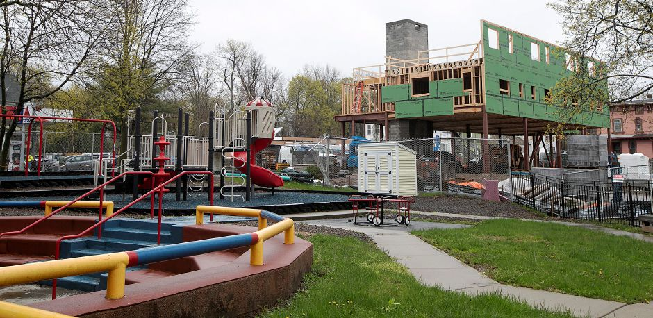 Construction continues on the Women & Families Center's WYSH House project next to the center's playground.