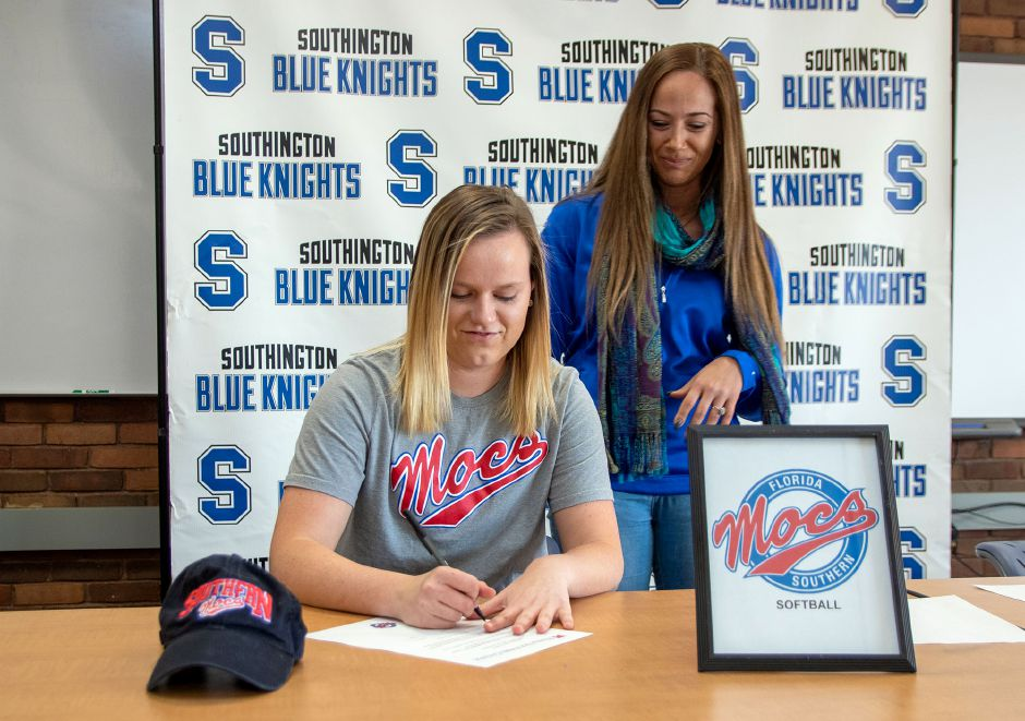 Southington High School's Katie Gundersen signs a letter of intent to Florida Southern University during a signing ceremony at the Southington Library on Wednesday, Nov. 13, 2019. Aaron Flaum, Record-Journal