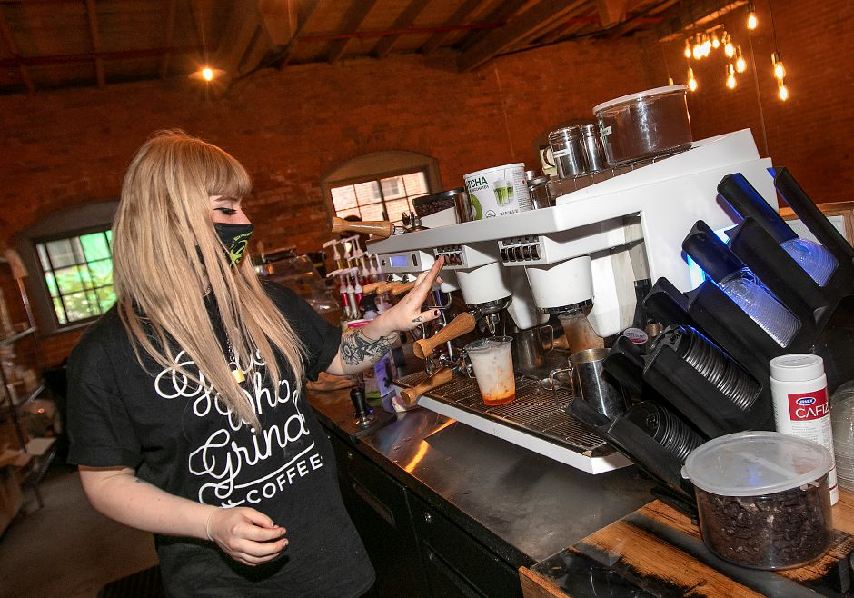 Barista Hanna Butterfield makes an Orange Creamsicle latte for a customer at Perkatory Coffee Roasters in Factory Square, 168 Center St. Suite 108 in Southington, Wed., Jun. 3, 2020. Dave Zajac, Record-Journal