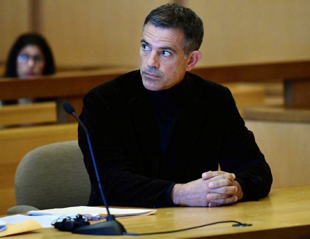 FILE: Fotis Dulos, charged with two counts of tampering with evidence and hindering prosecution in the disappearance of his wife, appears with his attorney Kevin Smith at Stamford Superior Court for a pre-trial hearing Friday, Oct. 4, 2019, in Stamford, Conn. (Erik Trautmann/Hearst Connecticut Media via AP)