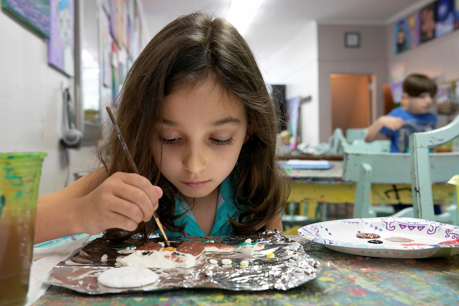 Emily Wargo, 8, of Cheshire, paints an owl figure as part of an art camp  at Catalyst Art Studio, 88 Center St., Wallingford, on Thursday. Photos by Dave Zajac, Record-Journal