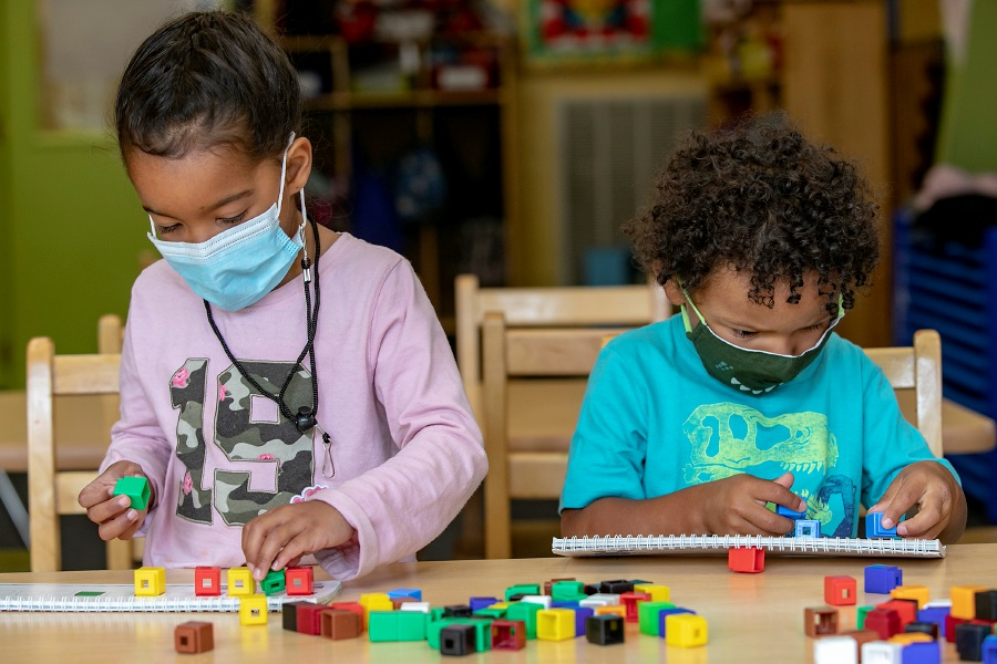Preschoolers Arianna Valentin, 4, left, and Gabriel Sinclair, 3, both of Meriden, wear masks while making patterns with blocks to build math skills at the Carriage House Day Care, 320 Colony St., Meriden, Tues., Sept. 22, 2020. The state Office of Early Childhood now requires children as young as three years old to wear masks while in an early childcare or pre-school setting. Dave Zajac, Record-Journal