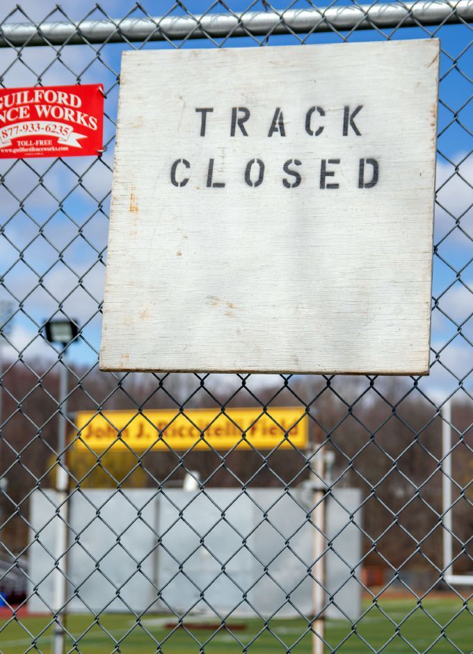 This sign hangs on the chain link fence that surrounds John J. Riccitelli Field at Sheehan High School in Wallingford. All athletic facilities at Sheehan have been closed since last week due to the COVID-19 crisis. Photos by Aaron Flaum, Record-Journal