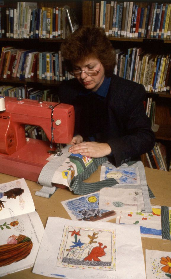 RJ file photo - Media specialist Marlene Barrante sews together pieces of Kelley School
