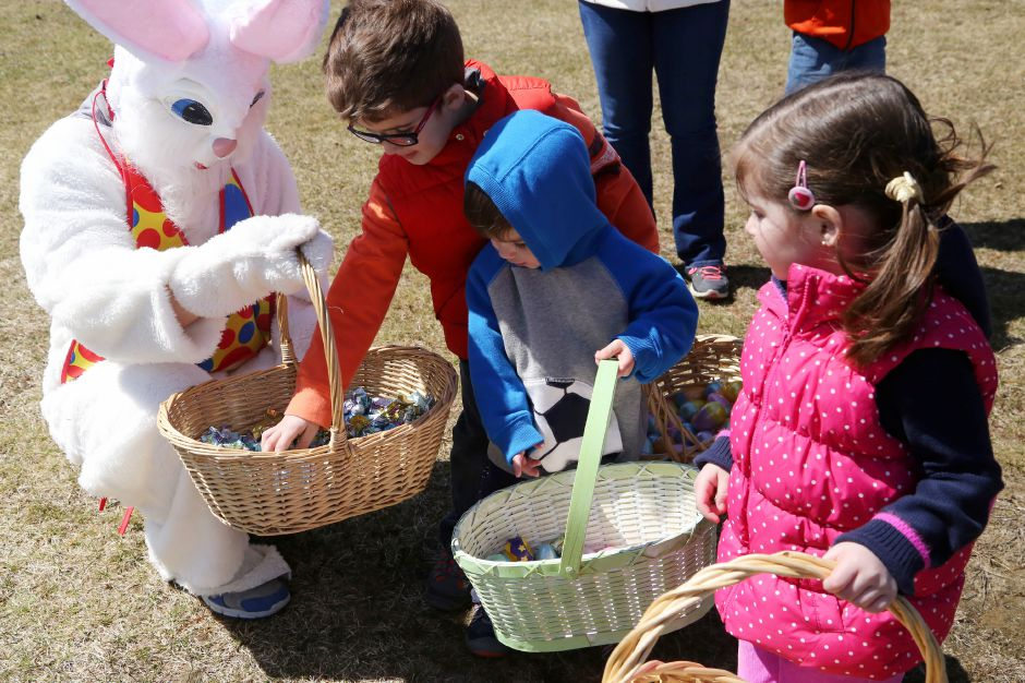 Greyson Moffitt, 6, of Ashaway, reaches for a piece of candy from the Easter bunny
