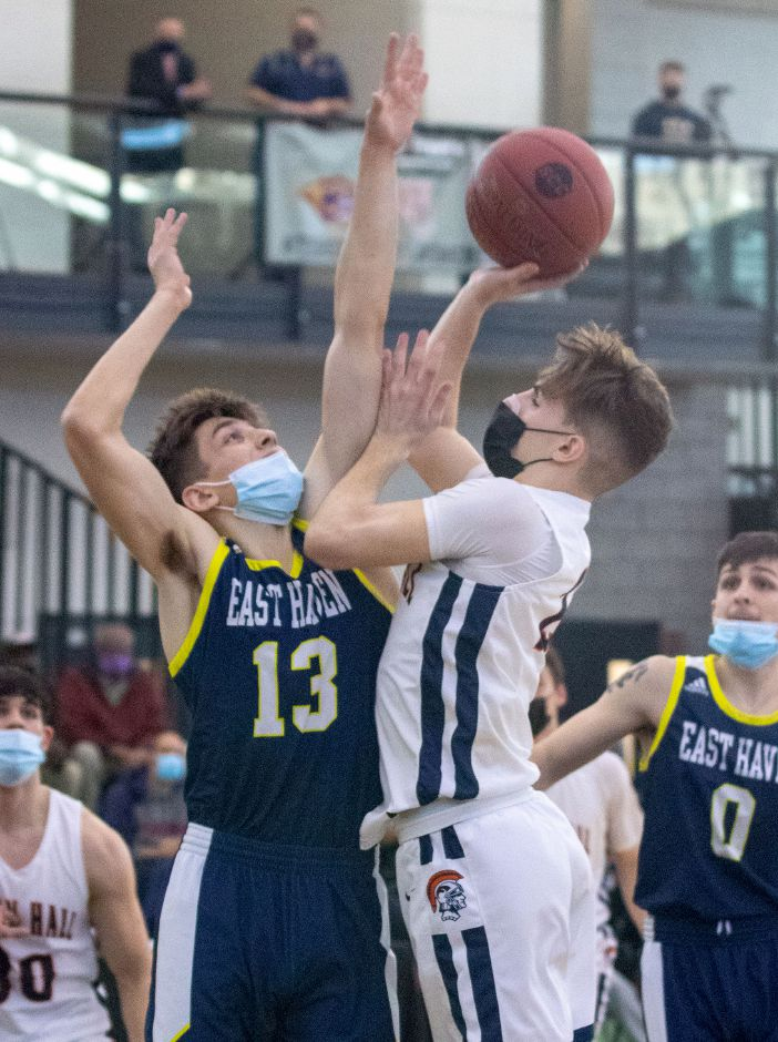 Lyman Hall's Ty Voisine gets fouled by East Haven's Nick Furino during Friday's SCC Divison II championship game at the Floyd Little Athletic Center. Aaron Flaum, Record-Journal