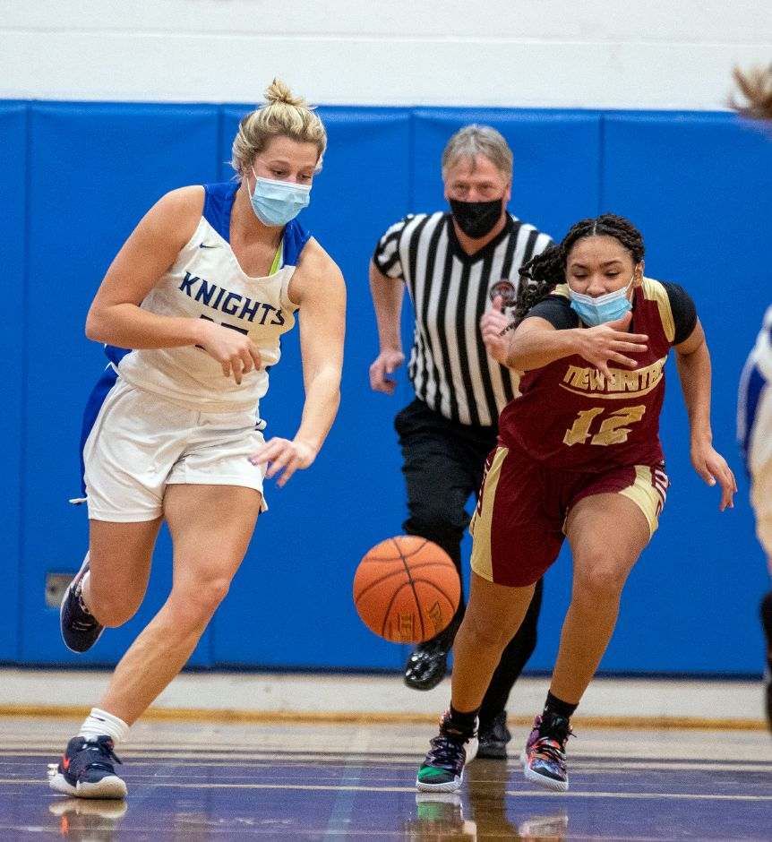 Southington's Allison Carr gets away from New Britain's Adrianna Faienza as she heads down the court during the first half at Southington High School on Wednesday, Feb. 10, 2021. Aaron Flaum, Record-Journal