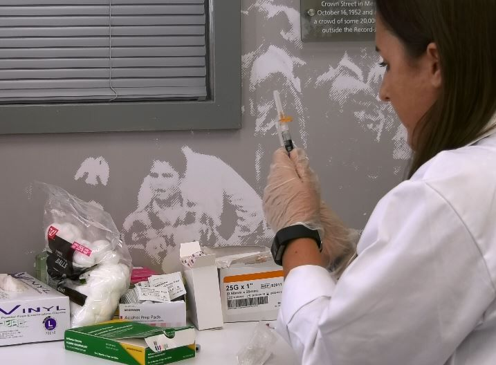 Meriden Walgreens pharmacist Nicole Davoren, of South Windsor, prepares a flu vaccine during a clinic at the Record-Journal office, Wed., Oct. 3. |Ashley Kus, Record-Journal
