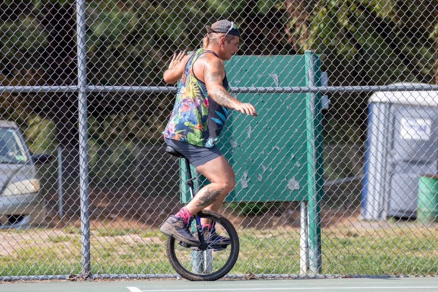 Wolfie Ventriglia of Wallingford works on learning to ride a unicycle at the tennis courts at Community Lake Park in Wallingford on Friday, September 25, 2020. Wolfie is learning to ride the unicycle to be part of his character for the upcoming Trails of Terror in Wallingford that opens on October 2, 2020. Aaron Flaum, Record-Journal