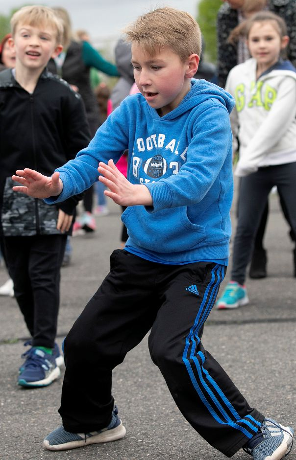 First-grade student Colin Haynes, 7, gets into the groove with his fellow classmates during Activate Southington