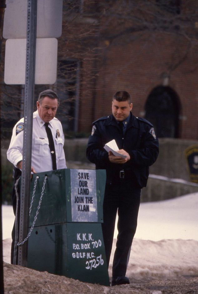 RJ file photo - Southington Police Capt. James Porter, left, and a patrol officer inspect literature supporting the Ku Klux Klan that was in a vending machine someone put outside police headquarters March 7, 1994.