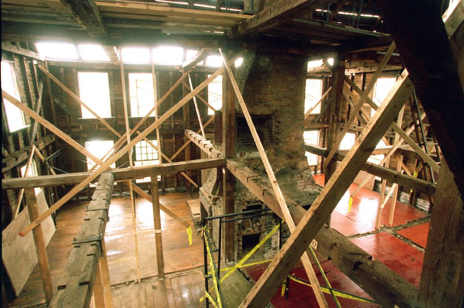 The Yale House on Route 5 in Wallingford is being dismantled piece by piece to be moved to a new location April 4, 2000. The chimney in the center of the room goes from the basement to the third floor or attic and will be taken apart brick by brick.