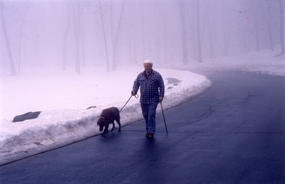RJ file photo - Don VanEmburgh of Meriden walks his Irish setter, Mike, through the morning fog at Hubbard Park March 8, 1994.