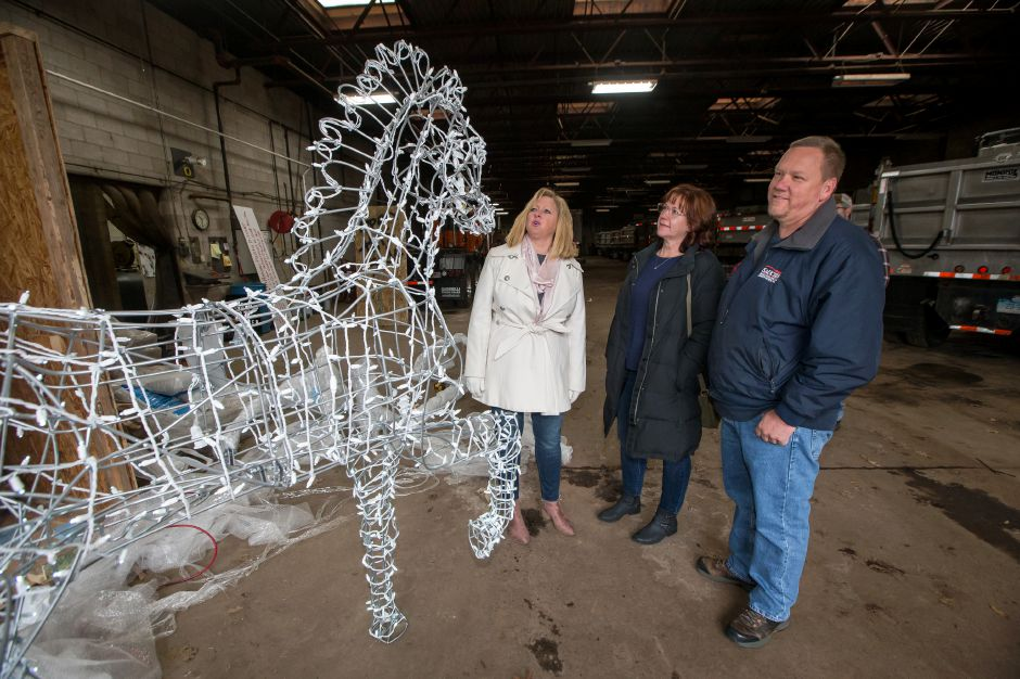 Dawn Miceli left looks at the assembled horse with Gary and Colleen Saucier who made the donation to purchase the horse Wednesday at the Southington Highway Department Garage in Southington November 21, 2018 | Justin Weekes / Special to the Record-Journal