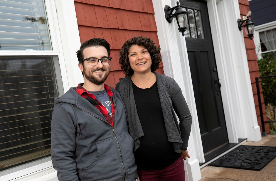 Casey Camire and wife Josina James stand on the front steps of their residence in Wallingford, Fri., Oct. 2, 2020. Camire, a 28-year-old chemical engineer and first time father-to-be, grew up in Meriden. He thinks Connecticut is a great state to live in, but is concerned about the state pension obligation. Dave Zajac, Record-Journal