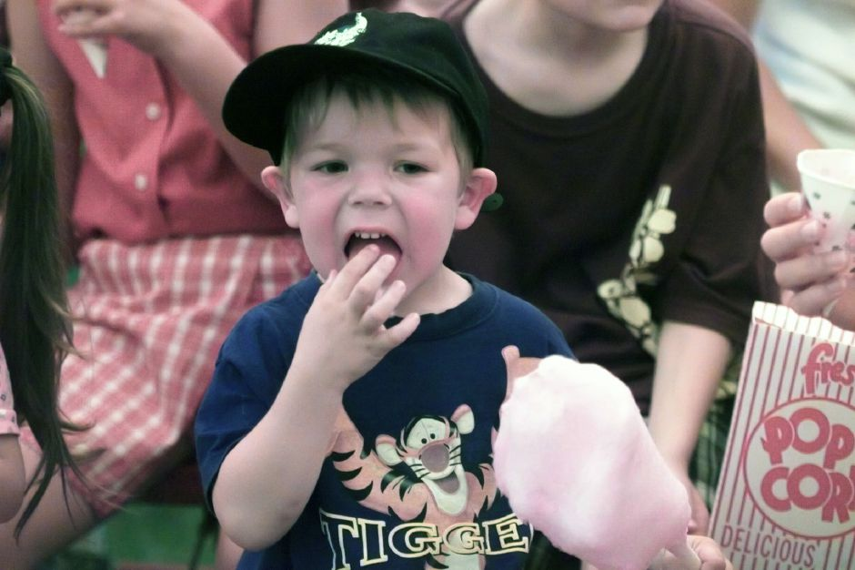 Tyler Kielv, 3, of Meriden, eats cotton candy during a performance of Vidbel