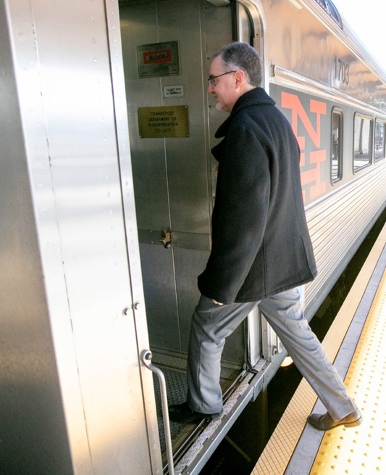 Joseph Geremia, chief financial officer of the Capital Region Development Authority, steps aboard a train to Hartford from the Meriden train station, Fri., Feb. 21, 2020. Geremia rides the train to work three or four days a week. Dave Zajac, Record-Journal