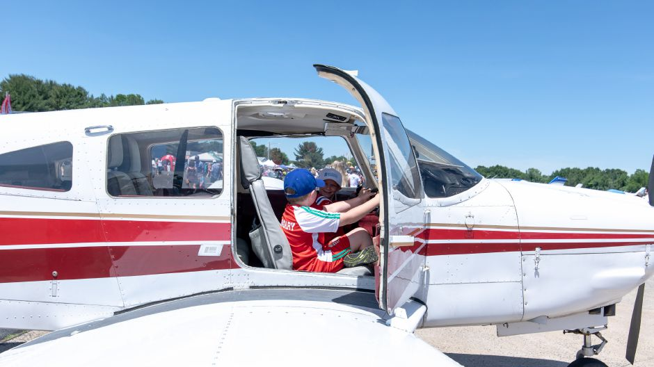 Gabriel Omilian plays in the cockpit of a Piper PA-28 on display during the Wings and Wheels car and air show at Robertson Airport in Plainville on June 8, 2019. | Devin Leith-Yessian/Plainville Citizen