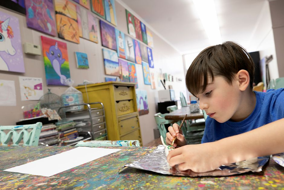 Liam Deschnow, 8, of Wallingford, paints a branch for his owl during an art camp at Catalyst Art Studio, 88 Center St., Wallingford, Thurs., Jul. 2, 2020. Dave Zajac, Record-Journal