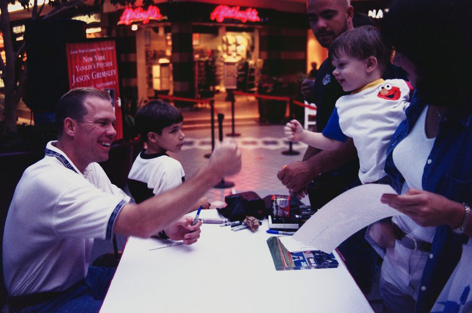 Jared Bartholomew, age 2 from Wallingford,smiles for his hero, Jason Grimsley, Yankee pitcher, who signs autographs at The Meriden Square Thursday night Sept. 9, 1999.